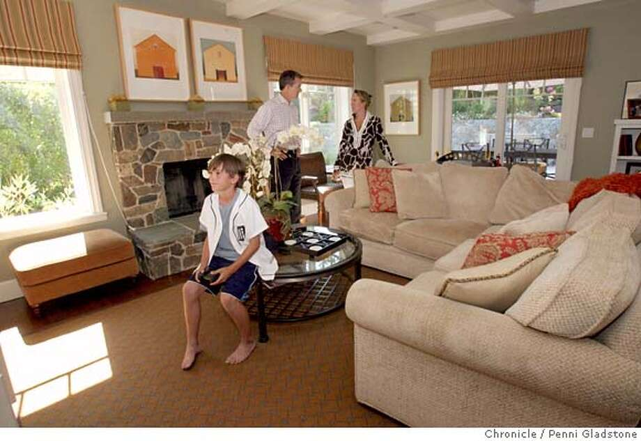 REX01_007_PG.JPG  Bill and Elaine Nolan with their son Graham at home.  San Francisco�s REX & Co. bills itself as the first company offering a way to liquify home equity without incurring debt. It essentially buys a share of a home�s future appreciation. REX gives homeowners a large upfront cash payment � up to 15 percent of a home�s value, topping off at $300,000 � in exchange for a share of the home�s future change in value � up to 50 percent of its future appreciation or depreciation. Event on 6/28/07 in Tiburon.  Penni Gladstone / The Chronicle MANDATORY CREDIT FOR PHOTOG AND SF CHRONICLE/NO SALES-MAGS OUT Photo: Penni Gladstone