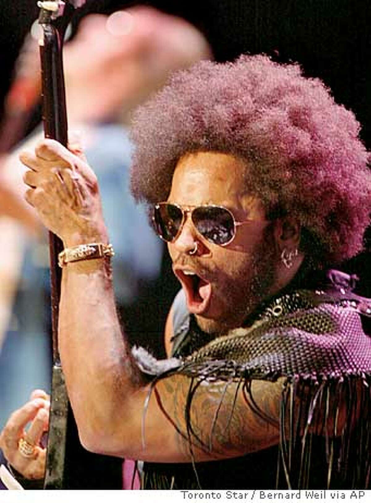 THIS IS A HANDOUT IMAGE. PLEASE VERIFY RIGHTS. Lenny Kravitz performs at Molson Amphitheater, in Toronto, Canada on Sunday Aug. 4, 2002. (AP Photo/CP, Toronto Star, Bernard Weil)
