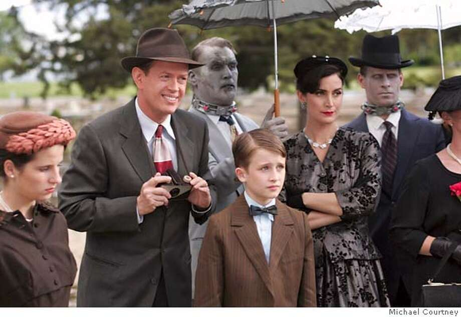 4. (L to R) Bill (Dylan Baker), Fido (Billy Connolly), Timmy (K'Sun Ray), and Helen (Carrie-Anne Moss), enjoy an afternoon at the cemetary. Photo credit: Michael Courtney Photo: Credit: Michael Courtney