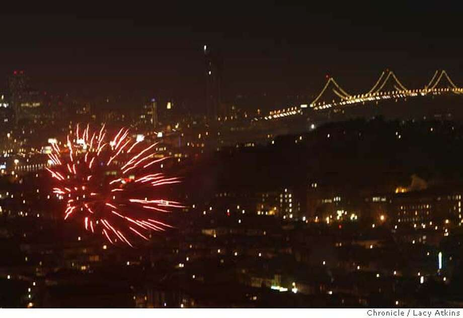 Fireworks over the city in celebration of the 4th of July 2007, in San Francisco, CA. (Lacy Atkins /San Francisco Chronicle) Ran on: 07-05-2007  Fireworks explode over San Francisco like flaming chrysanthemums bursting across the clear night sky. Photo: Lacy Atkins