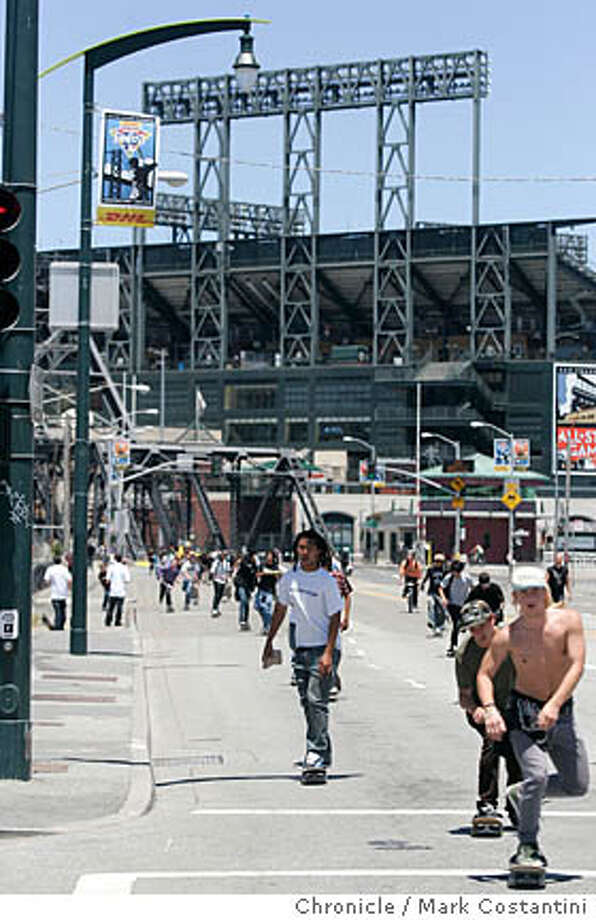 "Skateboarders ride through city streets near ATT Park.  This is a Fourth of July daily event story. Several hundred San Francisco-area skateboarders descend on city streets on the Fourth of July for ""Wild in the Streets 2007,"" a global grassroots skateboarding event that includes a five mile long route through San Francisco PHOTO: Mark Costantini / The Chronicle Photo: MARK COSTANTINI"