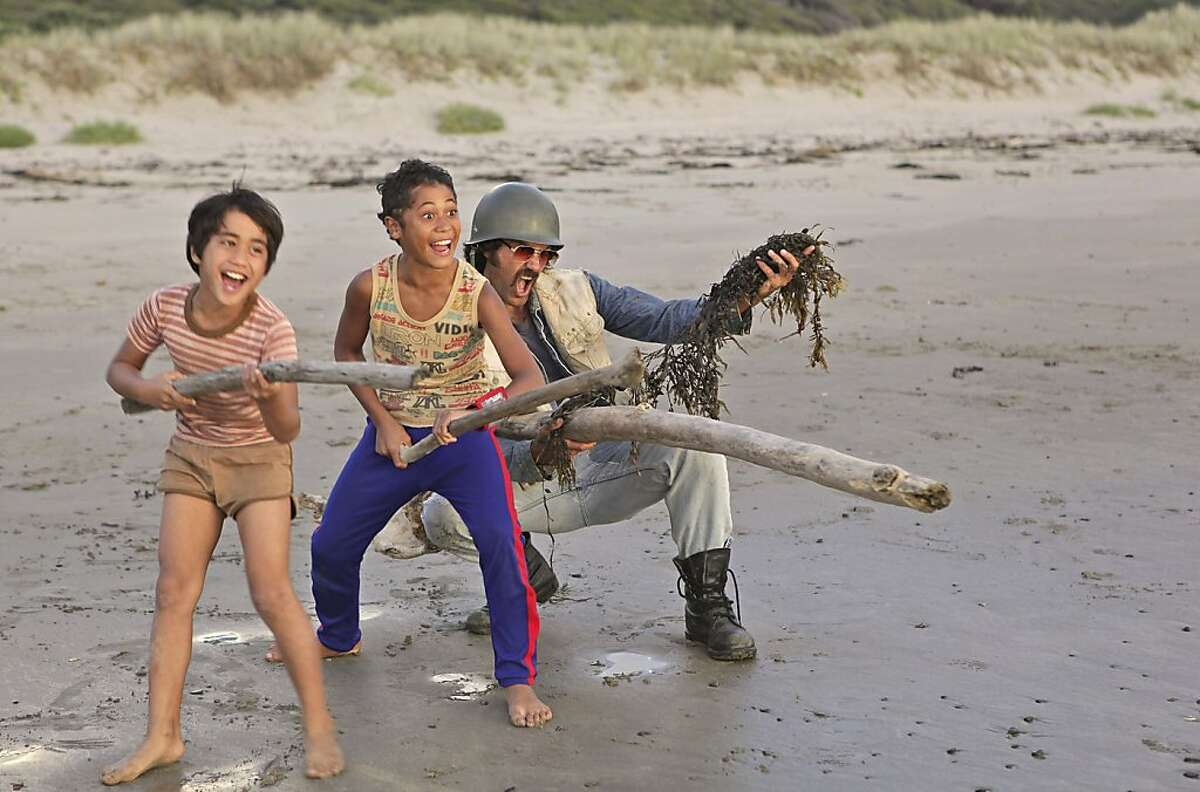 """An undated handout photo of, from left, Te Aho Eketone-Whitu, James Rolleston and Taika Waititi in """"Boy."""" The film, an unpretentious comic tale of a youngster's growing relationship with a long-absent father, was filmed in a Maori village near the Bay of Plenty. (Paladin via The New York Times) -- NO SALES; FOR EDITORIAL USE ONLY WITH STORY SLUGGED BOY-FILM-REVIEW. ALL OTHER USE PROHIBITED."""
