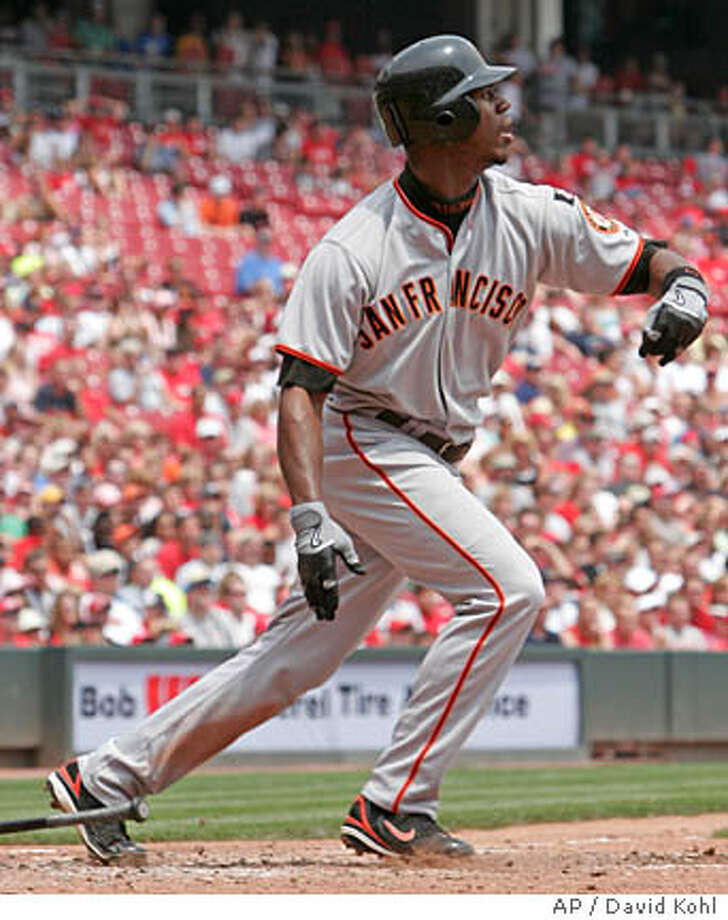 San Francisco Giants' Fred Lewis watches his grand slam off Cincinnati Reds pitcher Matt Belisle in the fourth inning of a baseball game, Wednesday, July 4, 2007, in Cincinnati. (AP Photo/David Kohl) Photo: David Kohl