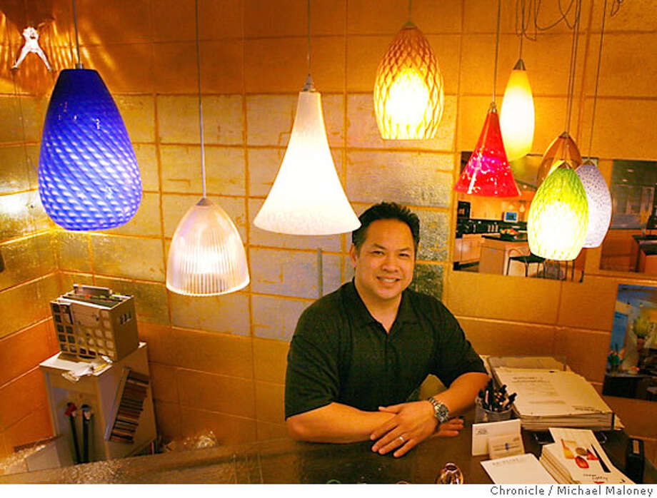Henry Chu, owner of Halogens Inc., 216 Broadway, in Millbrae, CA poses with some of the uniique low voltage halogen lighting systems sold in his store. Photo by Michael Maloney / San Francisco Chronicle ***Henry Chu Photo: Michael Maloney