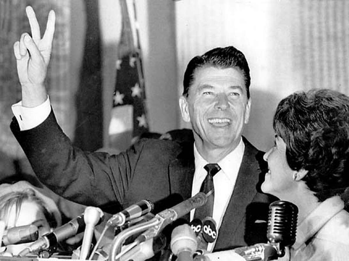 CAMPUS21-B-20DEC01-SN-FILE Ronald flashes the victory sign after he won the governorship of California over incumbent democratic governor Edmund G. (Pat) Brown. 's wife, Nancy, is at right.