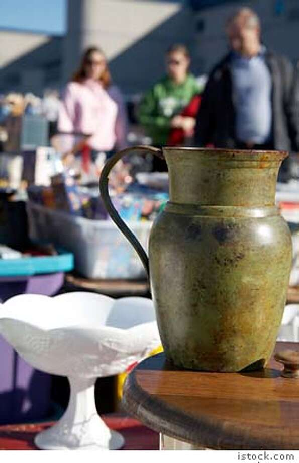 yard sales  Knick knacks on a table at a Flea Market (could be a garage sale?) Photo: Istock Handout Jim Jurica