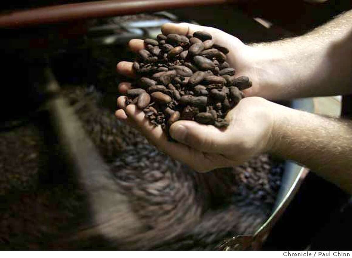 Brad Kintzer checks the quality of cacao beans from Grenada during the roasting process at the Scharffen Berger chocolate factory in Berkeley, Calif. on Tuesday, July 3, 2007. A study by German researchers claims that a daily dose of dark chocolate helps lower blood pressure. PAUL CHINN/The Chronicle **Brad Kintzer