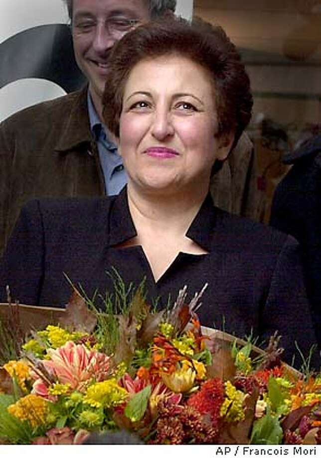 Iranian lawyer and activist Shirin , smiles as she gets a bouquet of flowers prior a press conference in Paris, Friday, Oct. 10, 2003. has been awarded on Friday the 2003 Nobel Peace Prize for her focus on human rights, especially on the struggle for the rights of women and children. (AP Photo/Francois Mori) Photo: FRANCOIS MORI