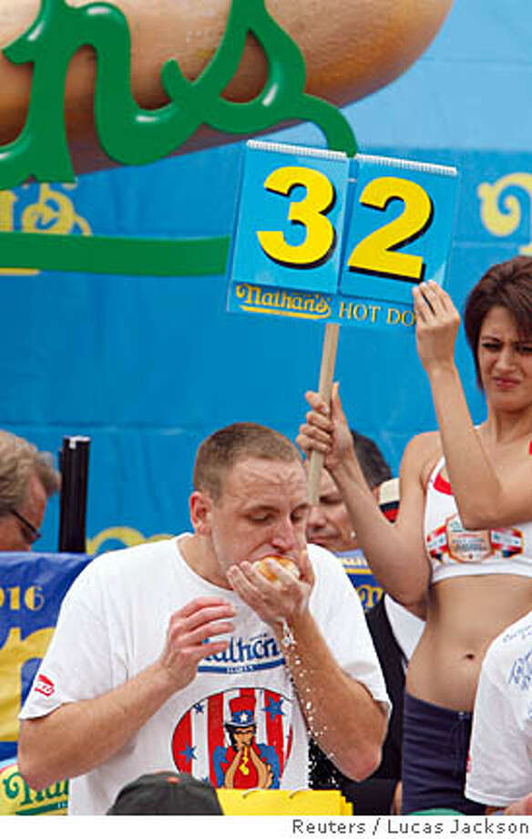 "Joey ""Jaws"" Chestnut eats his way through a pile of hot dogs during the 2007 Nathan's Famous Fourth of July International Hot Dog Eating Contest in the Coney Island neighborhood of New York July 4, 2007. Chestnut won the contest after eating a total of 66 hot dogs. REUTERS/Lucas Jackson (UNITED STATES) Photo: LUCAS JACKSON"