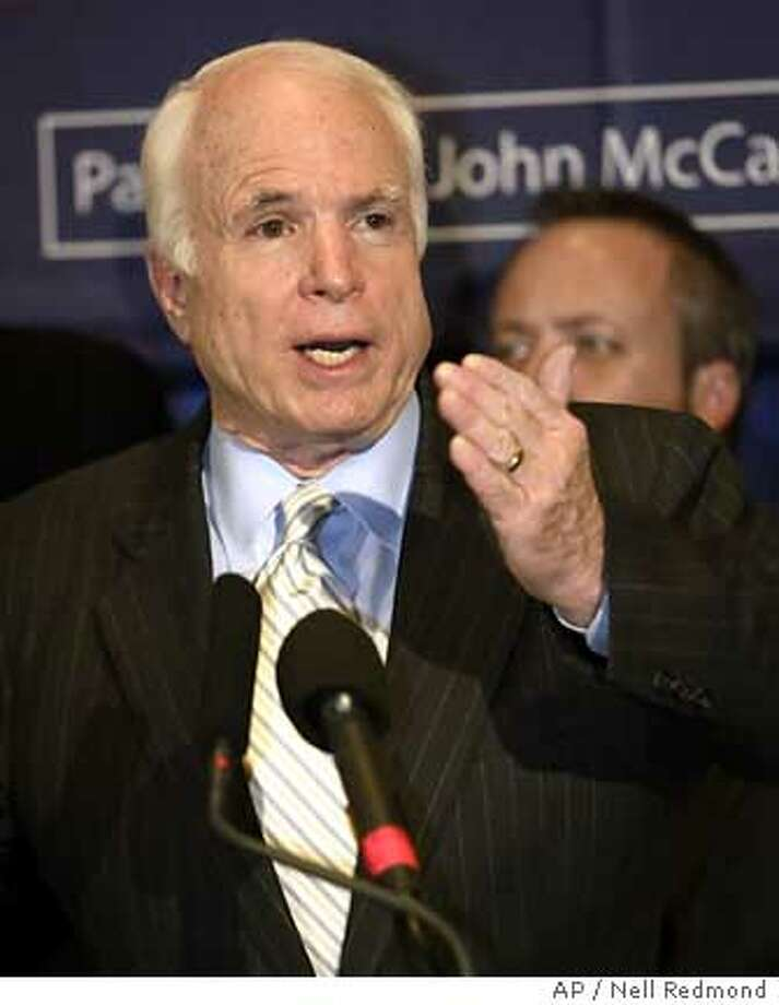 Republican presidential hopeful Sen. John McCain, R-Ariz., answers a question during a news conference in Greenville, S.C., on Monday, June 25, 2007. (AP Photo/Nell Redmond) Photo: Nell Redmond