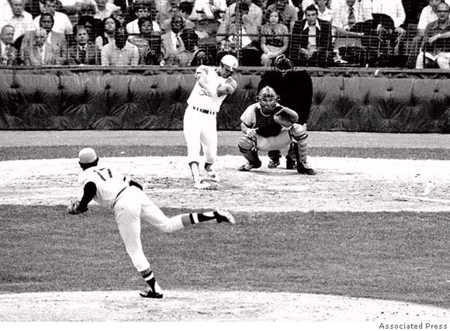 The American League's Reggie Jackson follows through on a towering third inning home run with a man on base in All-Star game in Detroit on July 13, 1971. National League pitcher is Dock Ellis of the Pittsburgh Pirates and catcher is Johnny Bench. Jackson's jolt started an American league comeback after Bench's second inning homer got the National League on the scoreboard. The Amercan League won the game 6-4, with two run homers by Jackson, Frank Robinson, and Harmon Killebrew. (AP Photo) Photo: AP