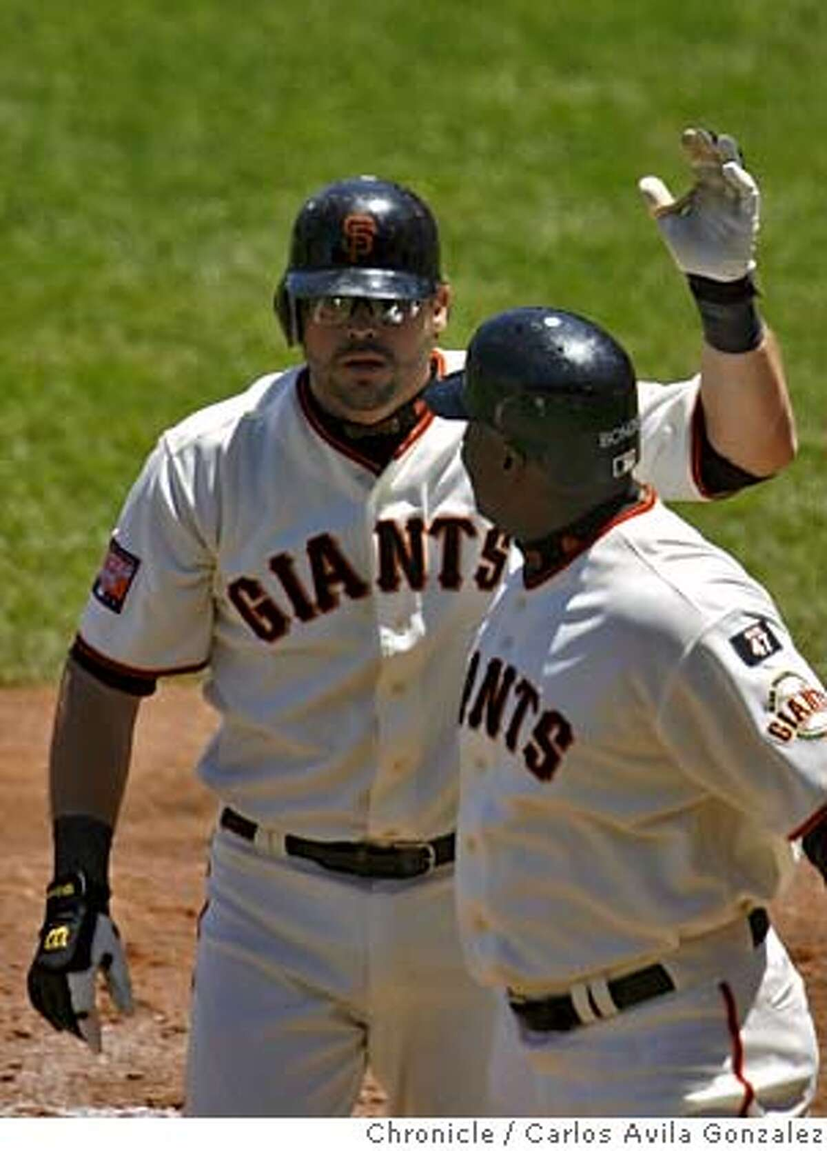 Ryan Klesko pats Barry Bonds on the back after the two scored on Klesko's two-run homerun in the bottom of the fourth inning. The Giants played the Arizona Diamondbacks at AT&T Park in San Francisco, on Sunday, July 1, 2007. The Giants won the game 13-0. Photo by Carlos Avila Gonzalez/The Chronicle Photo taken on 7/1/07, in San Francisco, Ca, USA. **All names cq (source)