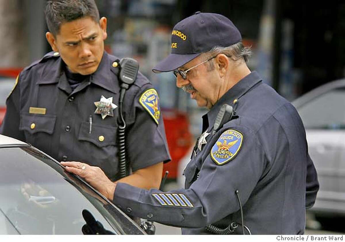 Marco Desangles is a Spanish-speaking officer. He is often called upon to translate for other officers. Here he helps officer Allan Agustin, a rookie, right, with a stop of an illegal alien on Mission Street. Marco Desangles is the oldest working cop on the beat in the Mission district. He just celebrated his 71st birthday and still enjoys going to work every day. He works both as a patrol officer and as a station supervisor filling in for sergeants when they are gone. {Brant Ward/San Francisco Chronicle}6/16/07