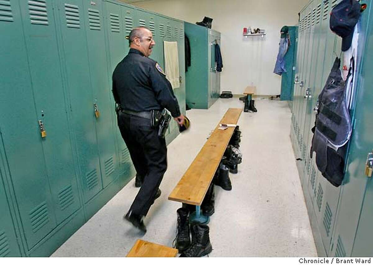 Officer Marco Desangles walks through the mens locker room at Mission station. The officers leave their big boots near the bench. Marco Desangles is the oldest working cop on the beat in the Mission district. He just celebrated his 71st birthday and still enjoys going to work every day. He works both as a patrol officer and as a station supervisor filling in for sergeants when they are gone. {Brant Ward/San Francisco Chronicle}6/16/07