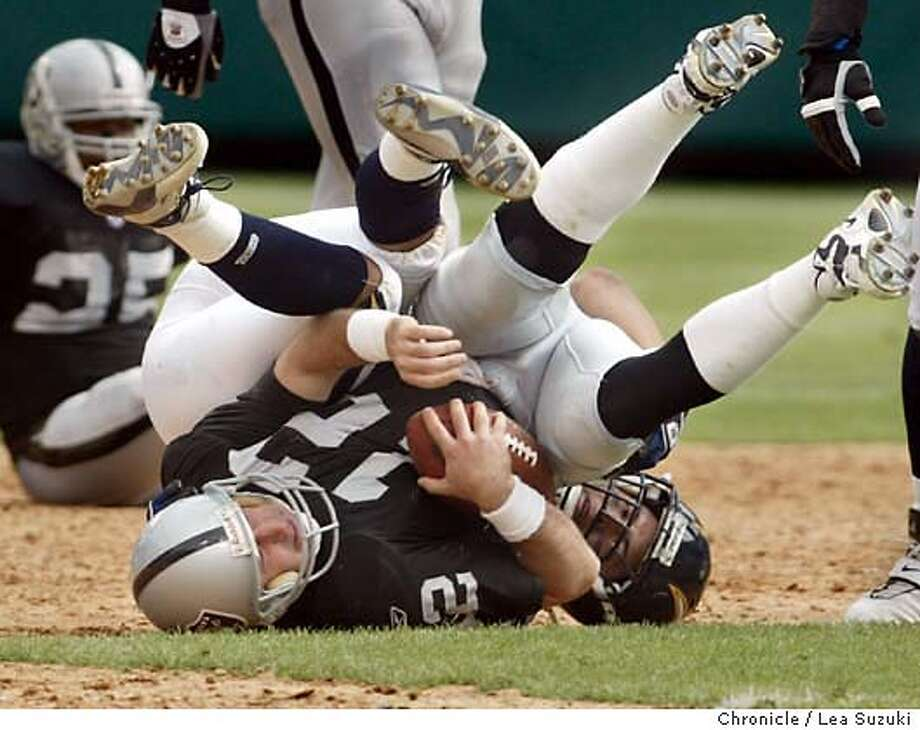 raiders244_ls.JPG Rich Gannon is sacked by Zeke Moreno during the second quarter. The Oakland Raiders played the San Diego Chargers at Network Associates Coliseum on 9/28/02 in Oakland, CA. Photo by Lea Suzuki/ The San Francisco Chronicle. Photo: Lea Suzuki