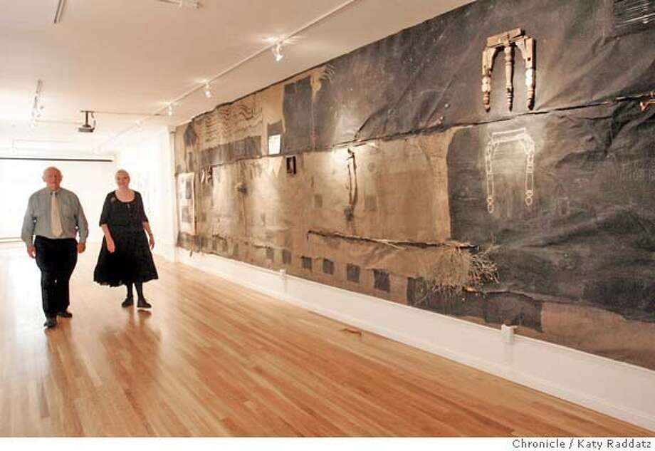 """� MERIDIAN02_032_RAD.jpg SHOWN: Founder Anne Brodzky and her husband and partner Tony Williams in the new third-floor gallery space (the galleries are on all three floors of the mansion). The big art work on the far right wall is called """"Muro"""" and is by Rolando Castellon. The Meridian Gallery recently lost its old home on Sutter St. and moved into its new home at 535 Powell St., in the historic Perine Mansion, which was built in 1911 by C.A. Meussdorffer. These pictures were made on Thursday, June 28, 2007 in San Francisco, CA. (Katy Raddatz/The Chronicle) **Anne Brodzky, Tony Williams, Rolando Castellon Mandatory credit for the photographer and the San Francisco Chronicle. No sales; mags out. .. Photo: Katy Raddatz"""