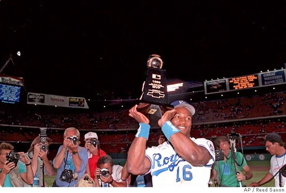 Bo Jackson holds up the MVP trophy after receiving the honor at the All-Star game in Anaheim, Ca., Tuesday, July 11, 1989. Jackson went 2-4 with a home run and a single and was credited with one stolen base. (AP Photo/Reed Saxon) Photo: REED SAXON