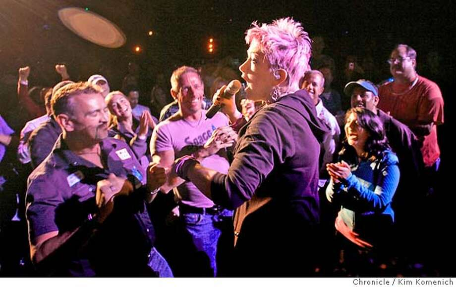 TRUE02_303_KK.JPG  Cyndi Lauper steps in to the audience as the True Colors tour stops at the Greek Theater in Berkeley. True Colors pairs some of the biggest stars of the '80s with younger bands they've inspired.  Photo by Kim Komenich/The Chronicle MANDATORY CREDIT FOR PHOTOG AND SAN FRANCISCO CHRONICLE. NO SALES- MAGS OUT. Photo: Kim Komenich