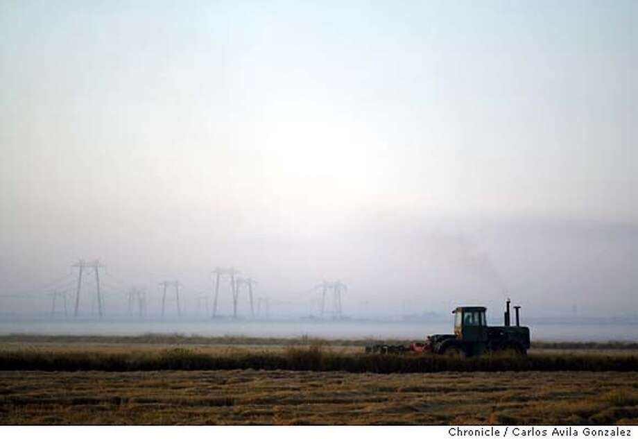A farmer plows a field south of Yuba City, Ca., on Thursday, October 9, 2003. Somewhere between the failing support for farms, cuts to education, and the power crisis of the early 2000's, the people of Sutter County decided that California Governor, Gray Davis, had to go. So quietly, and without much fanfare, they started the wheels turning. And on election day, they sent a resounding message to the halls of the Capitol in Sacramento, showing the highest percentage per capita to recall Davis and suprisingly, the highest percentage to elect Arnold Schwarzenegger.  Photo taken on 10/9/03, in Yuba City, CA. Photo By Carlos Avila Gonzalez / The San Francisco Chronicle Photo: Carlos Avila Gonzalez