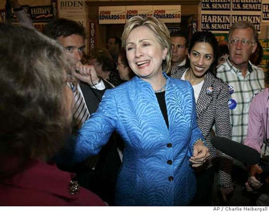 Democratic presidential hopeful U.S. Sen. Hillary Rodham Clinton, D-N.Y., talks with potential supporters before speaking at the Iowa Democratic Party's annual Hall of Fame Dinner, Saturday, June 2, 2007, in Cedar Rapids, Iowa. (AP Photo/Charlie Neibergall) Photo: Charlie Neibergall