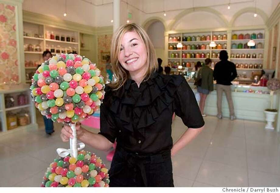 onthetown_devoe_0001_db.JPG  Andrea Arria-Devoe, editor of DailyCandy, Inc., checks out candy at Miette Confiserie on Octavia St. in San Francisco, CA, on Thursday, June, 21, 2007. photo taken: 6/21/07  Darryl Bush / The Chronicle ** Andrea Arria-Devoe (cq) Ran on: 07-01-2007  Andrea Arria-Devoe, editor of DailyCandy.com, displays the wares at Miette Confiserie on Octavia, where she goes for chocolate.  Ran on: 07-01-2007 Photo: Darryl Bush