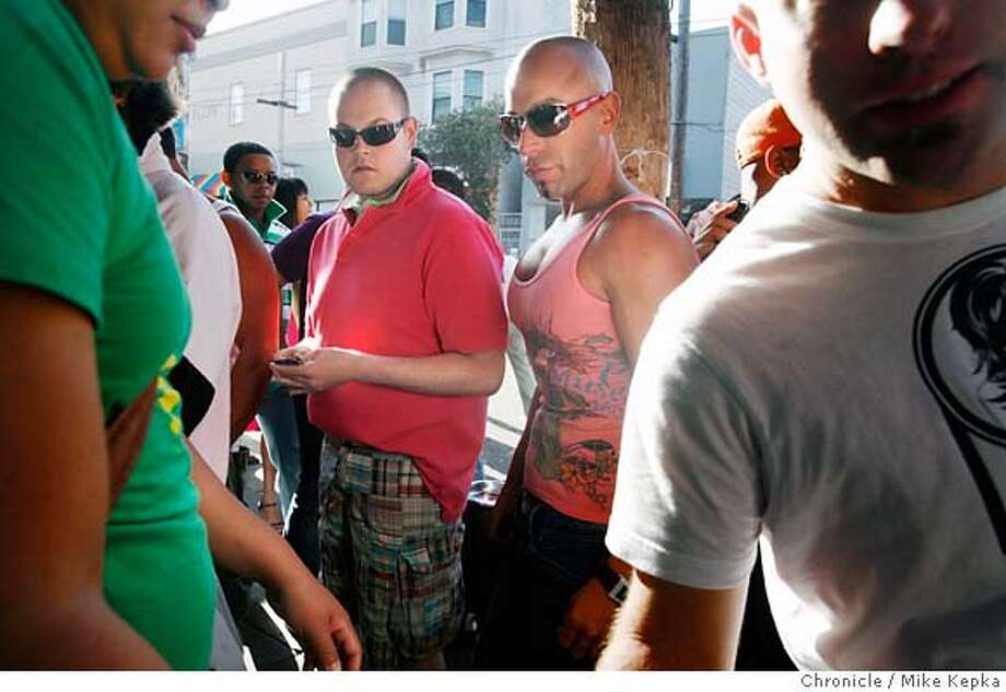 Blaring party music, enticing San Francisco's proudest revelers out of the open windows of SF Badlands on 18th street in in the Castro on Pink Saturday in 2007. Photo: Mike Kepka