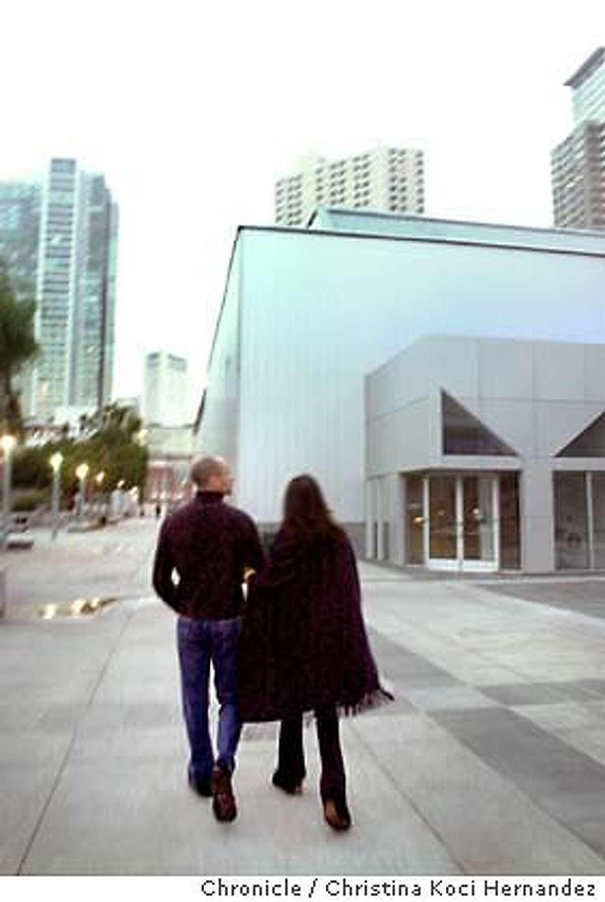{100403_yerba_kocihernandez} A couple strolls toward the Forum at Buena Center for the Arts.For the 10th anniversary on Buena Center for the Arts, as well as the gardens. Shot on10/03/03 in San Francisco. CHRISTINA KOCI HERNANDEZ / The Chronicle
