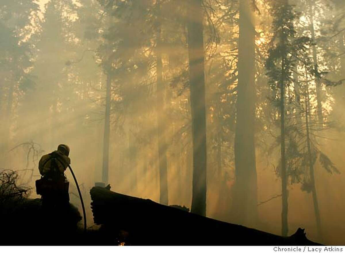 A firefighter wipes his eyes as he mops up after an afternoon of blazes, Tuesday June 26, 2007, in South Lake Tahoe, Ca. (Lacy Atkins /San Francisco Chronicle) MANDATORY CREDITFOR PHOTGRAPHER AND SAN FRANCISCO CHRONICLE/NO SALES-MAGS OUT