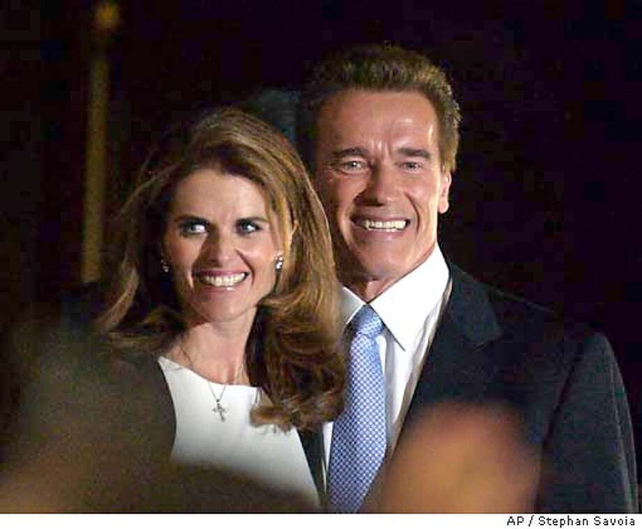 Republican Arnold Schwarzenegger, right, is joined by wife Maria Shriver following his victory in the California gubernatorial recall election in Los Angeles, Tuesday, Oct. 7, 2003. (AP Photo/Stephan Savoia) Photo: STEPHAN SAVOIA