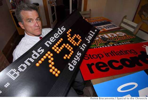 _DSC0013.jpg  Don Regole stands in front of signs that he designed, all criticizing Barry Bonds as he approaches the homerun record, in his Tucson, Arizona office, Friday, June 29, 2007. Regole says that he has not been allowed to bring these signs into games. By RENEE BRACAMONTE/SPECIAL TO THE CHRONICLE Photo: Renee Bracamonte