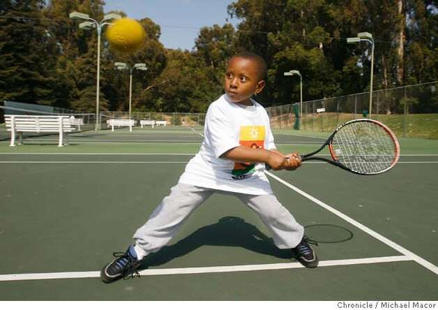 "� haasfamily_010_mac.jpg 6 year old Detric Eagles about to unleash a backhand shot. ""Team Up For Youth"" youth tennis program at Mills College. Magazine cover story on the Haas family (the descendants of Levi Strauss), and their legacy of philanthropic giving. This segment of story/photo shoot will look at a program called Team Up For Youth, which is funded by the Haas Jr. Fund and believes in the power of youth sports to change lives. This particular program within Team Up For Youth brings tennis and skilled coaching to inner city kids from Oakland. (cq) Detric Eagles Photographed in, Oakland, Ca, on 5/31/07. Photo by: Michael Macor/ The Chronicle Mandatory credit for Photographer and San Francisco Chronicle No sales/ Magazines Out Photo: Michael Macor"
