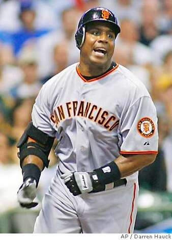 Compare Johnson's story to that of Barry Bonds (shown). Associated Press photo by Darren Hauck