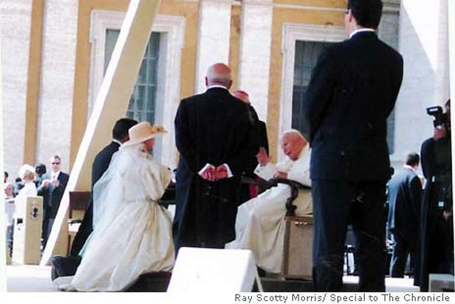 LEFT TO RIGHT Frank and Espina and Andi Valo kneel before Pope John Paul 2 as they are blessed after thier wedding at a chapel in St.Peter's Basilica in Rome Sept. 17  Ray Scotty Morris/ Special to The Chronicle Ray Scotty Morris
