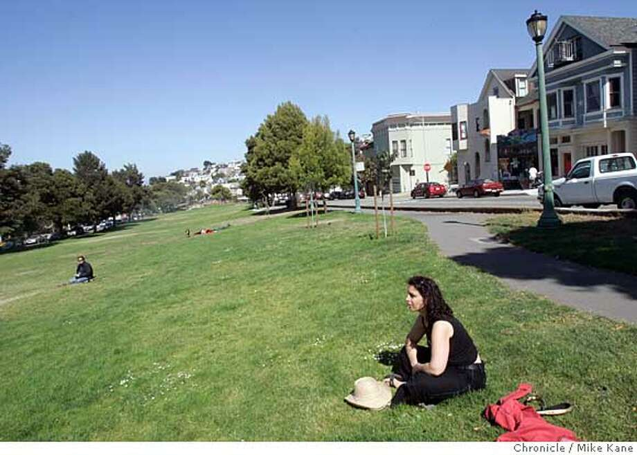 Oakland-based IT professional Leda Dederich sits in Garfield Square during a hike throughout San Francisco, CA, on Wednesday, June, 27, 2007. Dederich is taking the summer off from her high-pace, technologically demanding job in effort to enjoy such organic delights as hiking around the city. photo taken: 6/27/07  Mike Kane / The Chronicle *Ilyse Hogue Leda Dederich Photo: MIKE KANE