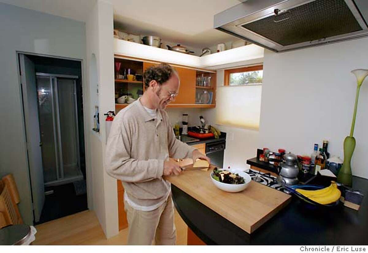 smallhousexx_076.JPG Dirk is pulling together a salad for dinner in his compact kitchen. Dirk Dieter's 210 square foot house in Pacifica. Photographer: Eric Luse / The Chronicle names (cq) from source Dirk Dieter MANDATORY CREDIT FOR PHOTOG AND SF CHRONICLE/NO SALES-MAGS OUT