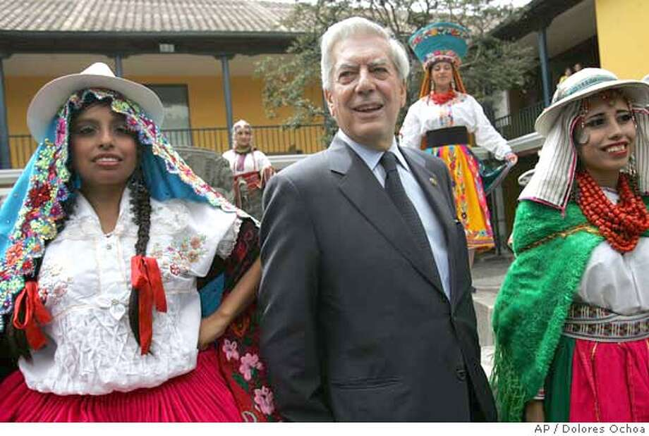"Peru's writer Mario Vargas Llosa posses with folkloric dancers at the city's museum in Quito, June 19, 2007. Vargas Llosa, who is in Ecuador after 20 years, was declarated ""distinguished guest"" by Quito's Mayor Paco Moncayo. (AP Photo/Dolores Ochoa) EFE OUT Photo: Dolores Ochoa"