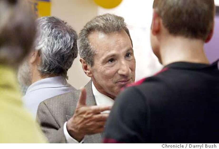 Tom Ammiano talks to a supporter at a campaign party held at his headquarters. 9/17/03 in San Francisco.  DARRYL BUSH / The Chronicle Photo: DARRYL BUSH