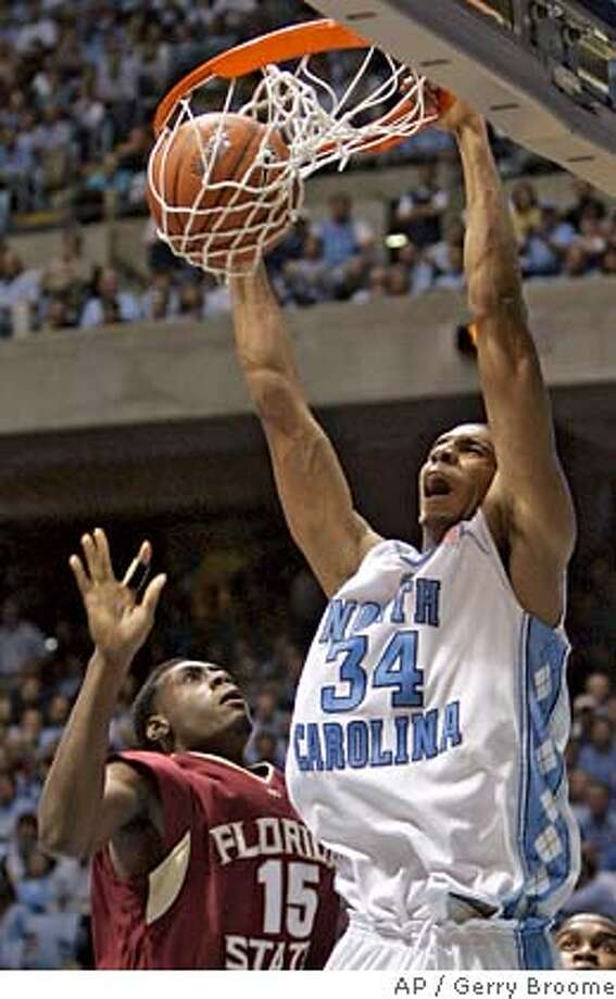** FILE ** North Carolina's Brandan Wright (34) slams a dunk over Florida State's Casaan Breeden (15) during the first half of a college basketball game in Chapel Hill, N.C., in this Jan. 7, 2007 file photo. Wright is one of the top prospects for the NBA Draft, to take place in New York on June 28. (AP Photo/Gerry Broome) Photo: Gerry Broome