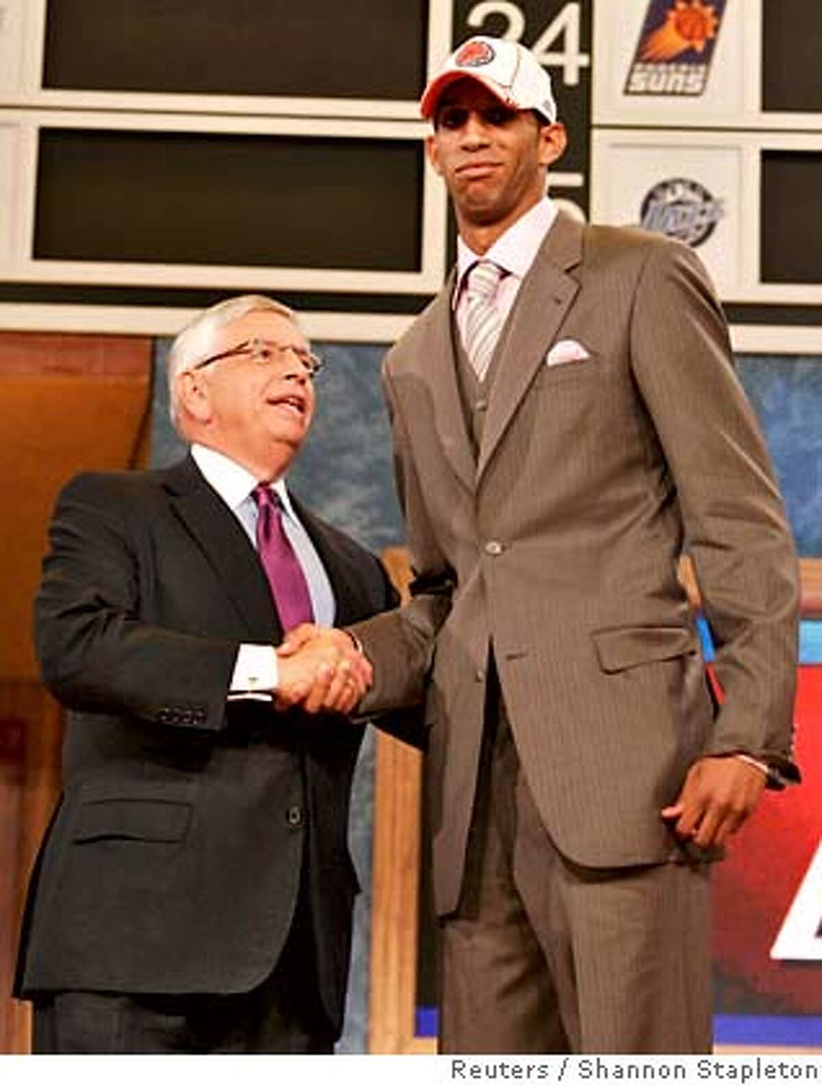 Brandan Wright of the University of North Carolina shakes hands with NBA Commissioner David Stern after being selected as the eighth overall pick by the Charlotte Bobcats at the 2007 at Madison Square Garden in New York June 28, 2007. REUTERS/Shannon Stapleton (UNITED STATES)