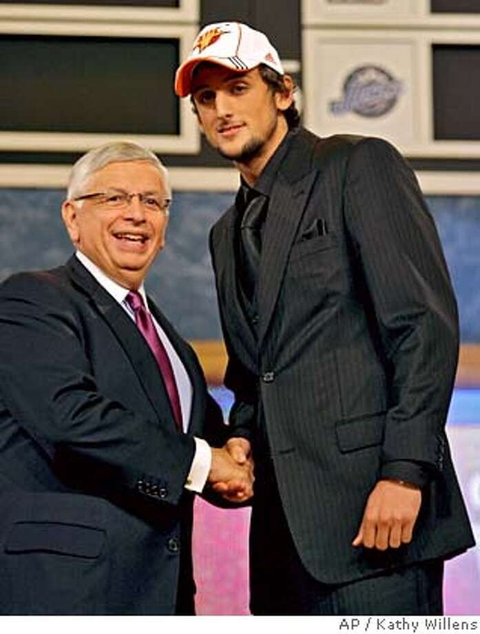 Marco Belinelli, right,of Italy, poses for a photo with NBA commissioner David Stern after being selected by the Golden State Warriors as the 18th overall pick in the 2007 NBA Draft, Thursday, June 28, 2007, in New York. (AP Photo/Kathy Willens) Photo: Kathy Willens
