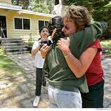 Juana Anthenien, left greets neighbor Kathi Jensen, right with a hug with Lydia Zuniga in the back, when the residents of Gardener Mountain return home, Wednesday June 27, 2007, after almost losing them Tuesday, return to see what in South Lake Tahoe, Ca. (Lacy Atkins /San Francisco Chronicle)  **Juana Anthenien  * Lydia Zuniga  ** Kathi Jensen  Ran on: 06-28-2007  Tim Memmer, a Forest Service firefighter, runs from a tree just seconds before it snapped and fell.  Ran on: 06-28-2007  Tim Memmer, a Forest Service firefighter, runs from a tree just seconds before it snapped and fell.