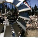 A windmill still stands among the debris Lake Tahoe Blvd shows the wind is low in the afternoon Wednesday June 27, 2007, in Meyers, Ca.  (Lacy Atkins /San Francisco Chronicle)