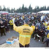 Ventura Fire Dept's Roger Dorn who is the Operations Section Chef on the Angora Fire in South Lake Tahoe gives his morning briefing to several hundred-fire bosses who will later pass on the info to their crews. The fire is now 44% contained but Fire Officials are warning everyone about high winds that could threaten homes closer to Lake Tahoe's shoreline east of HW 89. (June 27) (cq) SUBJECT) Lance Iversen / The Chronicle Photo taken on 6/27/07,in SOUTH LAKE TAHOE, CA.
