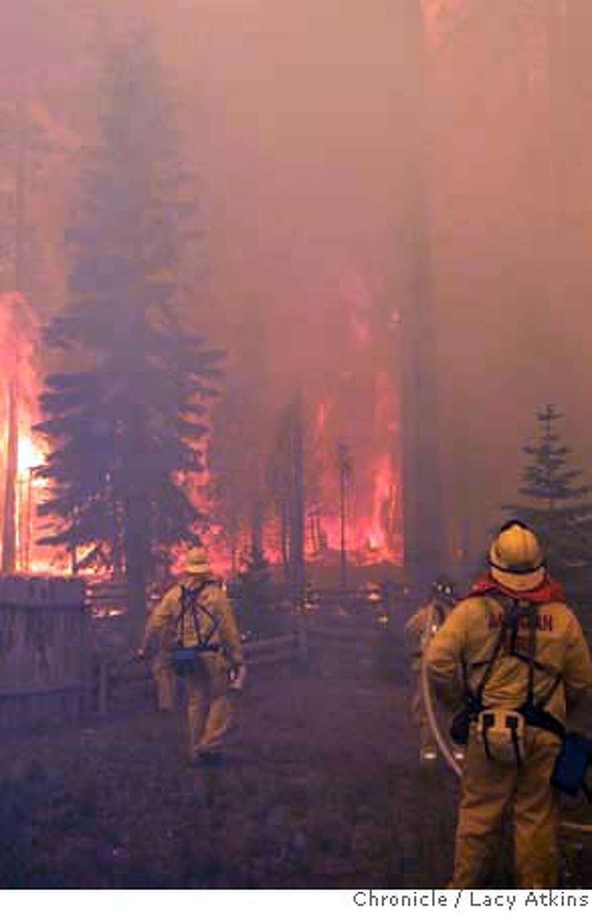 Firefighters watch as they try to control the fire, Tuesday June 26, 2007, in South Lake Tahoe, Ca. (Lacy Atkins / San Francisco Chronicle)