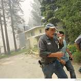 Mark Anthenien tries to make a call as he and his sons Jason and Greg evacuate their home as the flame get closer,Tuesday June 26, 2007, in South Lake Tahoe, Ca. (Lacy Atkins /San Francisco Chronicle)