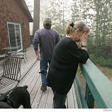 """"""" Even the flowers are still alive"""", cried Priscilla Tommei as she and her husband Al look into the backyard at their home on Mule Deer Circle, Tuesday June 26, 2007 as they arrive for the first time since the fire in Meyers, CA.(Lacy Atkins /San Francisco Chronicle)  * Priscilla and Al Tommei"""