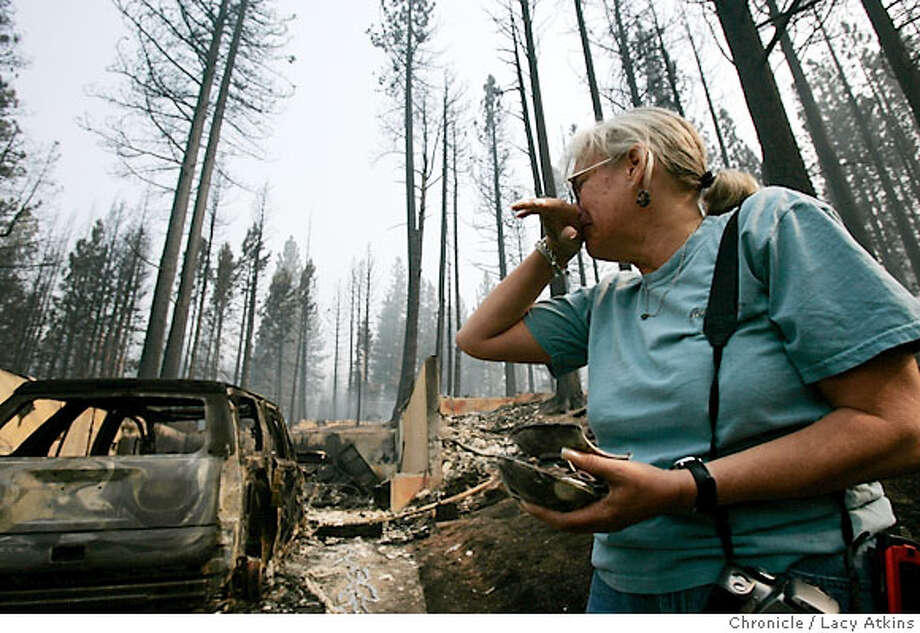 Missy Springer cries as she turns to leave her home at 767 Angora Creek, after seeing it for the first time Tuesday June 26, 2007, since the fire, in Meyers, Ca. (Lacy Atkins /San Francisco Chronicle)  *Missy Springer Photo: Lacy Atkins