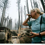 Missy Springer cries as she turns to leave her home at 767 Angora Creek, after seeing it for the first time Tuesday June 26, 2007, since the fire, in Meyers, Ca. (Lacy Atkins /San Francisco Chronicle)  *Missy Springer