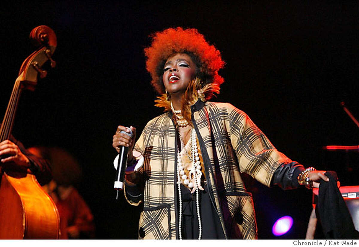 LAURYN29_0185_KW.JPG Singer Lauryn Hill of the Fugees makes a live appearance at the Paramount Theater in Oakland 10 years after releasing her solo albumn on Wednesday evening June 27, 2007. Many people walked out and demanded a refund when the singer showed up 55 minutes for her scheduled 9 o'clock performance. Kat Wade/The Chronicle (CQ, subject) Ran on: 06-29-2007 Lauryn Hills voice was often drowned out by a blaring sound system.