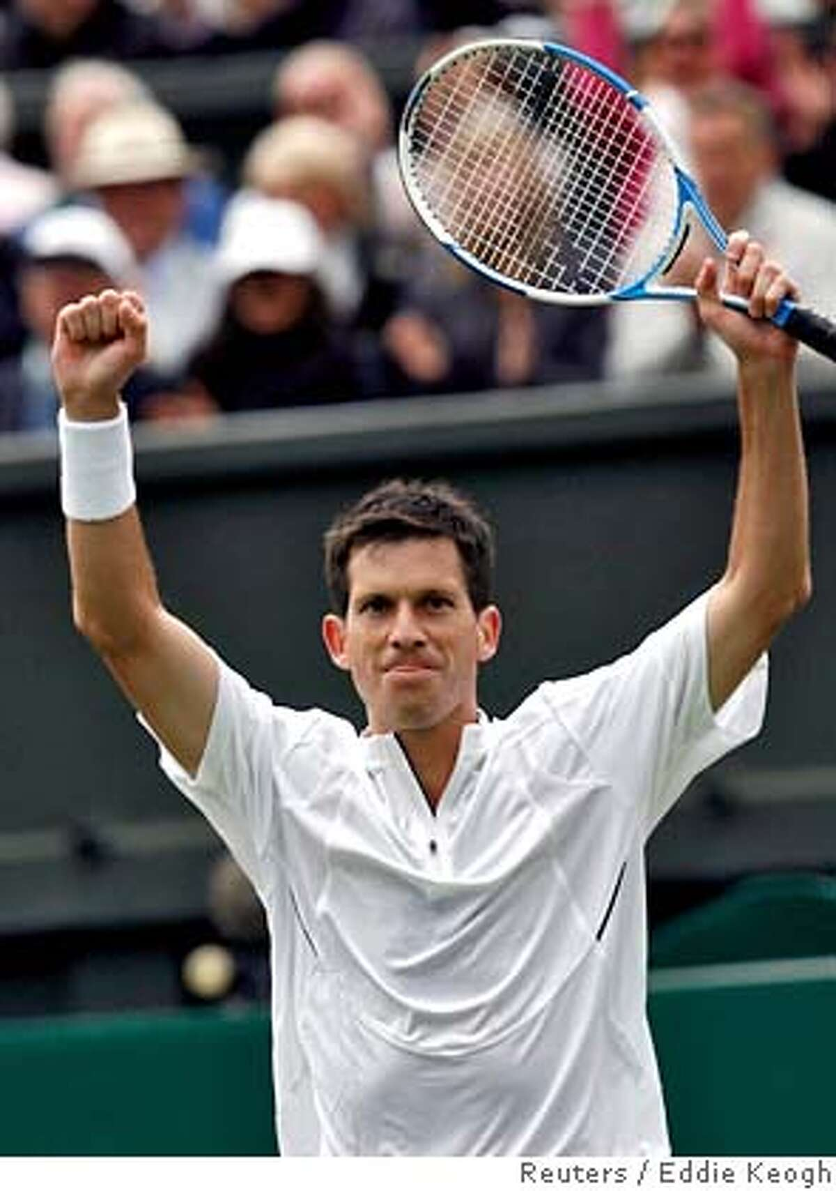 Britain's Tim Henman celebrates on the centre court after beating Spain's Carlos Moya at the Wimbledon tennis championships in London June 26, 2007. REUTERS/Eddie Keogh (BRITAIN) Ran on: 06-27-2007 Tim Henman celebrates his win over Spains Carlos Moya at Centre Court.
